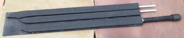 Various sword blades incomplete on a bulk 'bat'